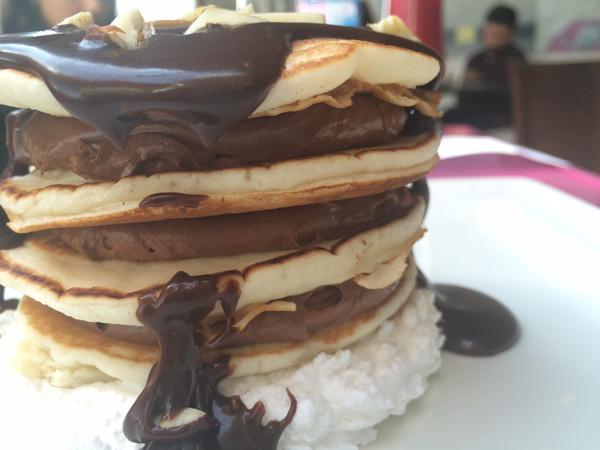 Belgian Chocolate pancakes topped with ganache and nuts